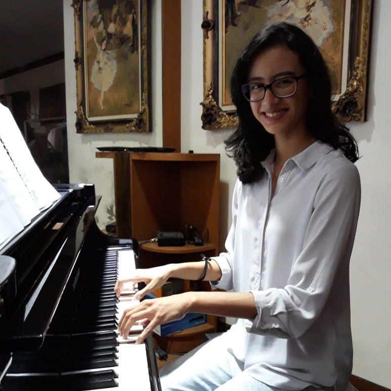 Piano Teacher - Kartika Pratiwi